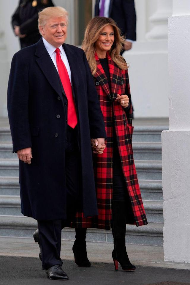 "<p>Melania Trump attended the White House Christmas tree delivery on November 19 wearing a festive tartan <a href=""https://www.neimanmarcus.com/en-gb/p/michael-kors-collection-double-breasted-tartan-plaid-cape-coat-prod212670066?ecid=NMAF__Skimlinks.com&CS_003=5630585&utm_medium=affiliate&utm_source=NMAF__Skimlinks.com"" rel=""nofollow noopener"" target=""_blank"" data-ylk=""slk:cape"" class=""link rapid-noclick-resp"">cape</a> by Michael Kors and £1,200 thigh-high Christian Louboutin <a href=""http://us.christianlouboutin.com/us_en/shop/women/alta-top-veau-velours.html"" rel=""nofollow noopener"" target=""_blank"" data-ylk=""slk:boots"" class=""link rapid-noclick-resp"">boots</a>. <em>[Photo: Getty]</em> </p>"
