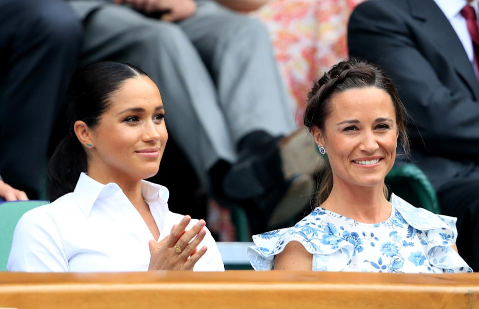 The Duchess of Sussex alongside Pippa Matthews on day twelve of the Wimbledon Championships at the All England Lawn Tennis and Croquet Club, Wimbledon.