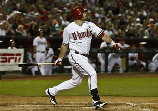 Arizona Diamondbacks' Jason Kubel connects for a double in the fourth inning against the St. Louis Cardinals during an opening day baseball game Monday, April 1, 2013, in Phoenix. (AP Photo/Ross D. Franklin)