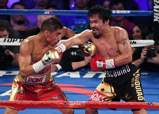 Manny Pacquiao (R) lands a right during his title-winning effort over Jessie Vargas on Nov. 5. (Getty Images)