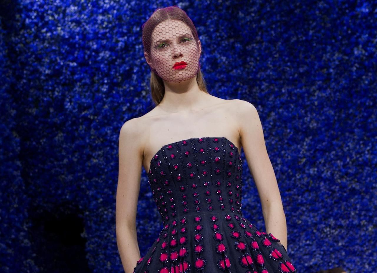 A model wears a creation by fashion designer Raf Simons for Dior, during his Women's Fall Winter 2013 haute couture fashion collection, during fashion week in Paris, France, Monday, July 2, 2012. (AP Photo/Jacques Brinon)