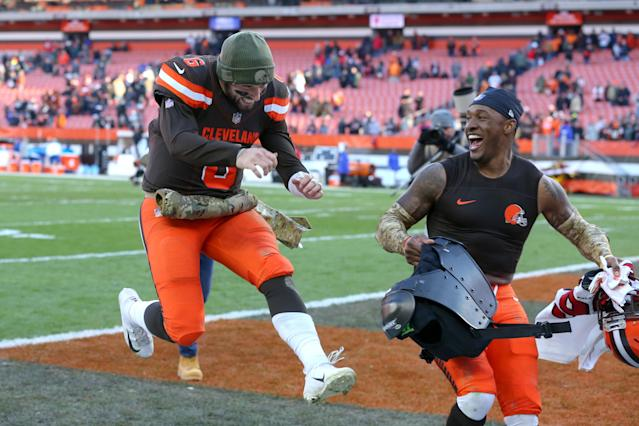 Browns quarterback Baker Mayfield (6) and safety Damarious Randall were all smiles after Cleveland's 28-16 victory on Sunday against Atlanta. (Getty Images)