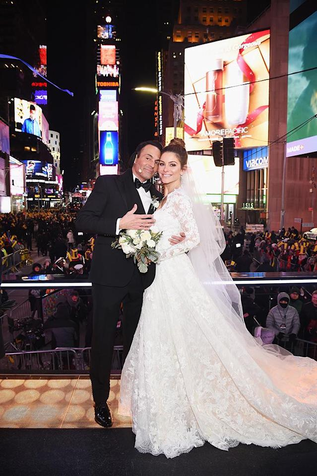 <p>Talk about a happy new year! The TV host surprised viewers (and her own family!) by tying the knot with her longtime boyfriend live in Times Square while hosting Fox's New Year's Eve celebration. Menounos's co-host, Steve Harvey, had the honor of officiating the ceremony in front of the freezing cold crowd. It was a beautiful ending to a tough year for the 39-year-old TV host, who had a brain tumor removed in June. (Photo: Dimitrios Kambouris/Getty Images for MM) </p>