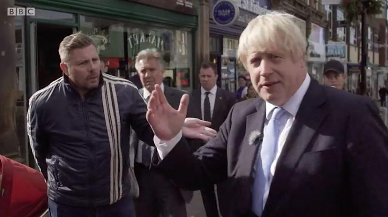 <strong>Boris Johnson being heckled during a walkabout in Morley, Leeds&nbsp;</strong> (Photo: BBC )