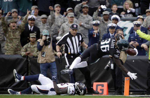 <p>Philadelphia Eagles' Jay Ajayi (36) scores a touchdown over Denver Broncos' Darian Stewart (26) during the first half of an NFL football game, Sunday, Nov. 5, 2017, in Philadelphia. (AP Photo/Matt Rourke) </p>