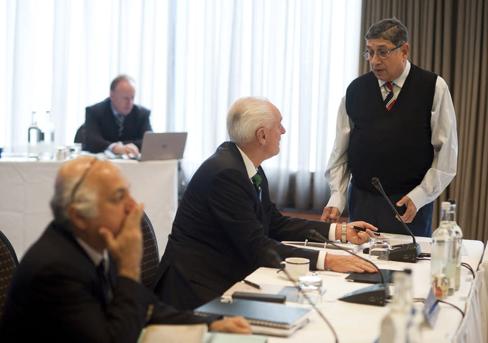 India's N Srinivasan chats to Wally Edwards of Australia during the ICC Board Meeting at The Royal Garden Hotel on October 18, 2013 in London, England. (Photo by Charlie Crowhurst/Getty Images)