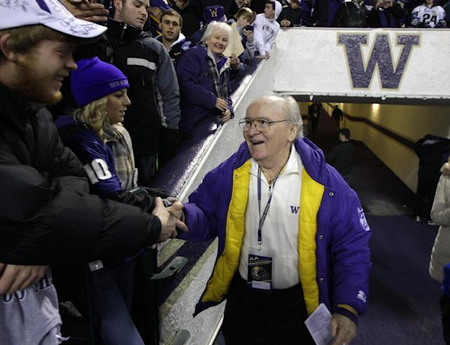 FILE - In this Nov. 5, 2011 file photo, former University of Washington football coach Don James greets fans prior to an NCAA college football game against Oregon, in Seattle. James, the longtime Washington football coach who led the Huskies to a share of the national championship in 1991, died Sunday, Oct. 20, 2013. He was 80. (AP Photo/Ted S. Warren, File)