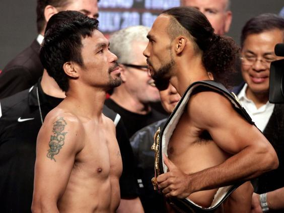 Manny Pacquiao and Keith Thurman fight for the WBA super welterweight world title (AFP/Getty)
