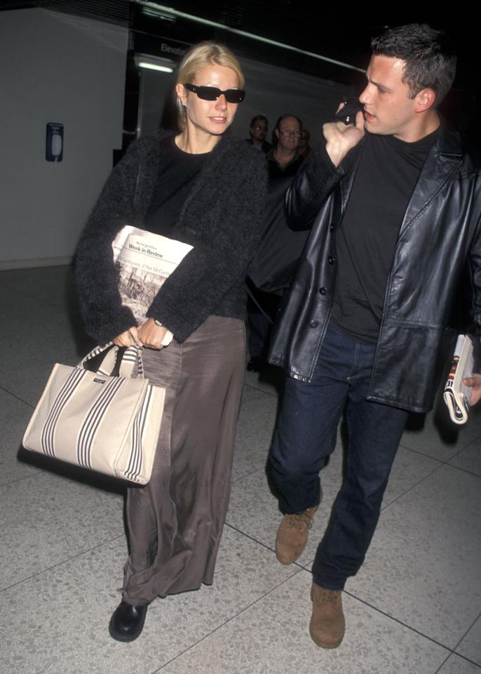 <p>We feel a tinge of nostalgia coming on, as Gwyneth Paltrow proved Kate Spade's fashion status by carrying a supersized tote by the label through LAX airport back in 1998. <em>[Photo: Getty]</em> </p>