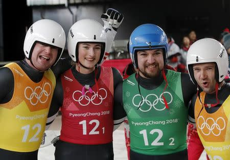 Luge - Pyeongchang 2018 Winter Olympic Games - Team Relay - Pyeongchang, South Korea - February 15, 2018 - Bronze medalists Madeleine Egle, David Gleirscher, Peter Penz and Georg Fischler of Austria celebrate. REUTERS/Arnd Wiegmann