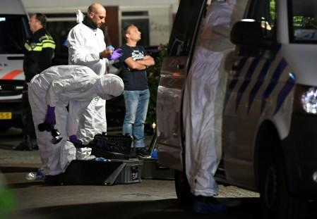 Forensic technicians are seen following a shooting in Dordrecht