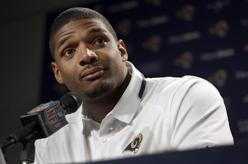 St. Louis Rams seventh-round draft pick Michael Sam listens to a question during a news conference at the NFL football team's practice facility Tuesday, May 13, 2014, in St. Louis