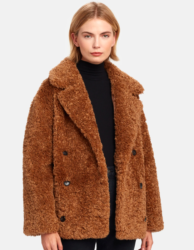 """The buttons and oversized lapel on this furry coat make it a bit more elevated than your average teddy, so it's great for staying warm during dinner dates and other events that force you to leave the house in subzero temps. $248, Verishop. <a href=""""https://www.verishop.com/more-than-yesterday/coats-jackets-blazers/teddy-faux-fur-coat/p4113826545687"""" rel=""""nofollow noopener"""" target=""""_blank"""" data-ylk=""""slk:Get it now!"""" class=""""link rapid-noclick-resp"""">Get it now!</a>"""