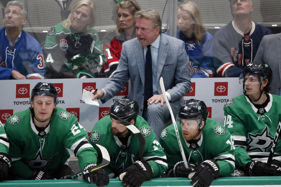 FILE - In this March 10, 2020, file photo, Dallas Stars interim head coach Rick Bowness yells from the bench as they played the New York Rangers during the third period of an NHL hockey game in Dallas. The 65-year-old Dallas Stars coach is hockey's version of Kevin Bacon in that he's got some connection to almost everyone, and for the first time, he's leading a team that's now six wins away from the Stanley Cup. (AP Photo/Michael Ainsworth, File)