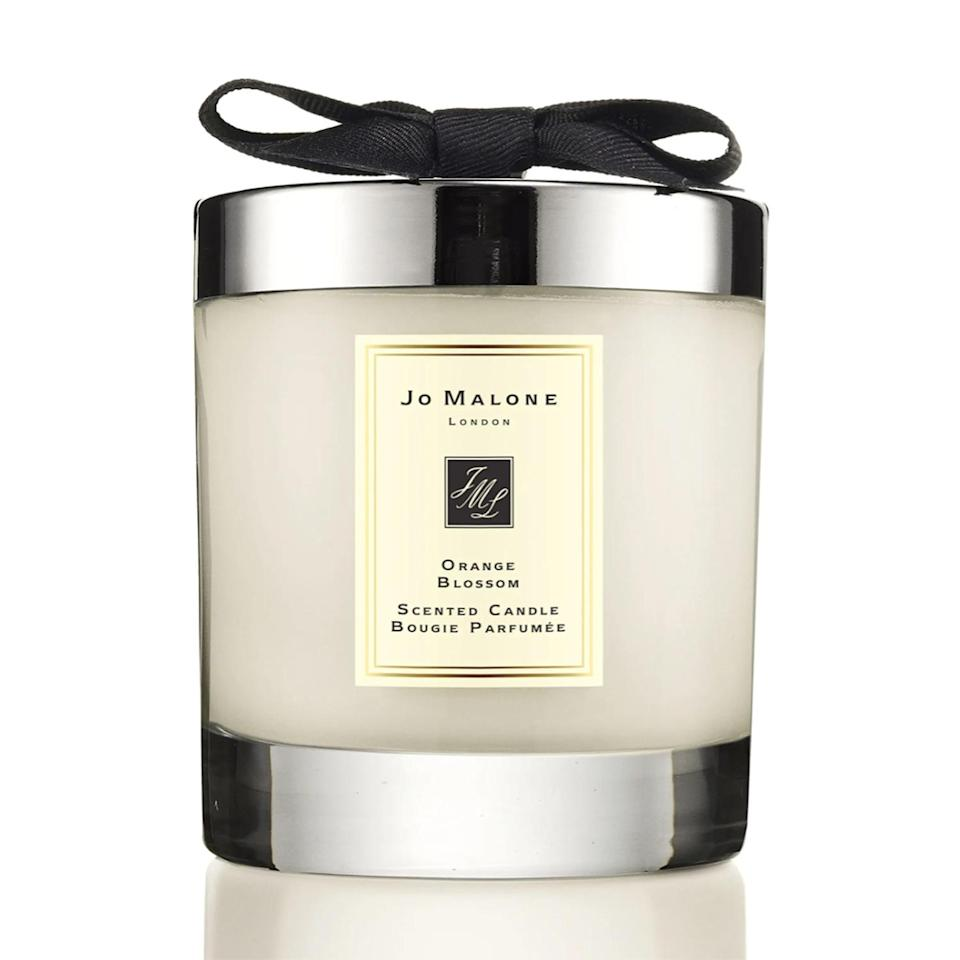 """<p>The Duke and Duchess of Cambridge filled the air with Jo Malone's Orange Blossom candle for their 2011 wedding. It's the perfect scent to help royal lovers spring into summer.</p> <p><strong>Buy It! Jo Malone Orange Blossom Scented Home Candle, <a href=""""https://click.linksynergy.com/deeplink?id=93xLBvPhAeE&mid=1237&murl=https%3A%2F%2Fwww.nordstrom.com%2Fs%2Fjo-malone-london-orange-blossom-scented-home-candle%2F3010775&u1=PEO11RoyalsInspiredGiftsYouNeedThisSummerpetitsRoyGal12744024202106I"""" rel=""""sponsored noopener"""" target=""""_blank"""" data-ylk=""""slk:$69"""" class=""""link rapid-noclick-resp"""">$69</a></strong></p>"""