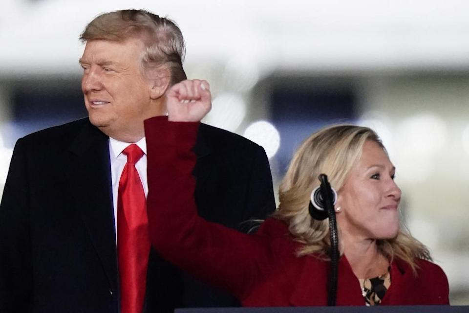 Marjorie Taylor Greene and Donald Trump at a campaign rally for Georgia Republicans in Dalton on 4 January.