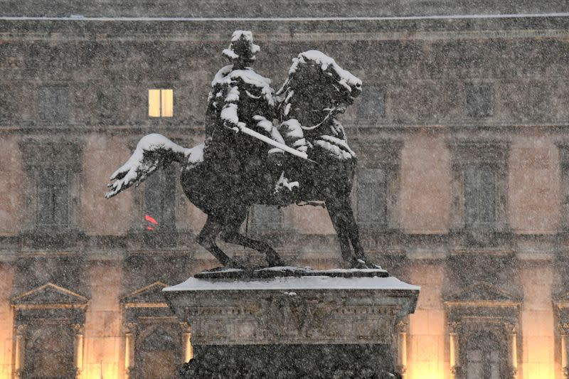 Snow falls in Milan