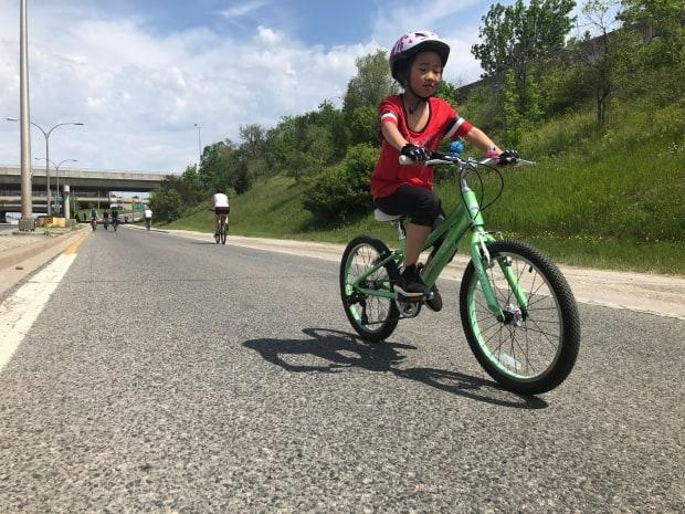 A young cyclist finds freedom on Allen Road on Saturday. The northbound lanes of Allen Road are closed between Eglinton Avenue West and Lawrence Avenue West on Saturday as part of ActiveTO. (Robert Krbavac/CBC - image credit)