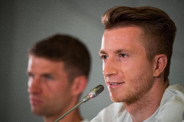 Marco Reus (R) is set to boost Germany's flagging attack in Saturday's crucial match against Sweden in Sochi at the World Cup after the holders lost their opener against Mexico. (AFP Photo/Odd ANDERSEN)