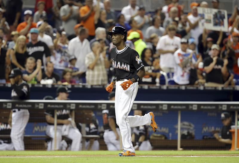 Dee Gordon cries as he rounds the bases after his home run. (AP)