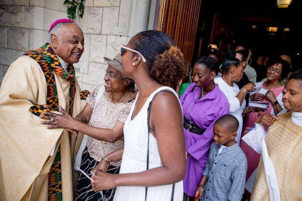 PHOTO: Washington D.C. Archbishop Wilton Gregory, left, greets parishioners following Mass at St. Augustine Church in Washington, June 2, 2019. (Andrew Harnik/AP, FILE)