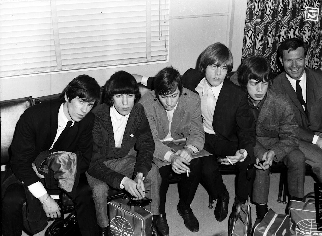 The Rolling Stones are interviewed by Mike Walsh shortly after arriving at Mascot Airport, January 21 1965. (Photo by Trevor Dallen/The Sydney Morning Herald/Fairfax Media via Getty Images).