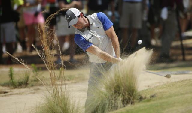 Rory McIlroy, of Northern Ireland, hits from the natural area on the third hole during the final round of the U.S. Open golf tournament in Pinehurst, N.C., Sunday, June 15, 2014. (AP Photo/Chuck Burton)