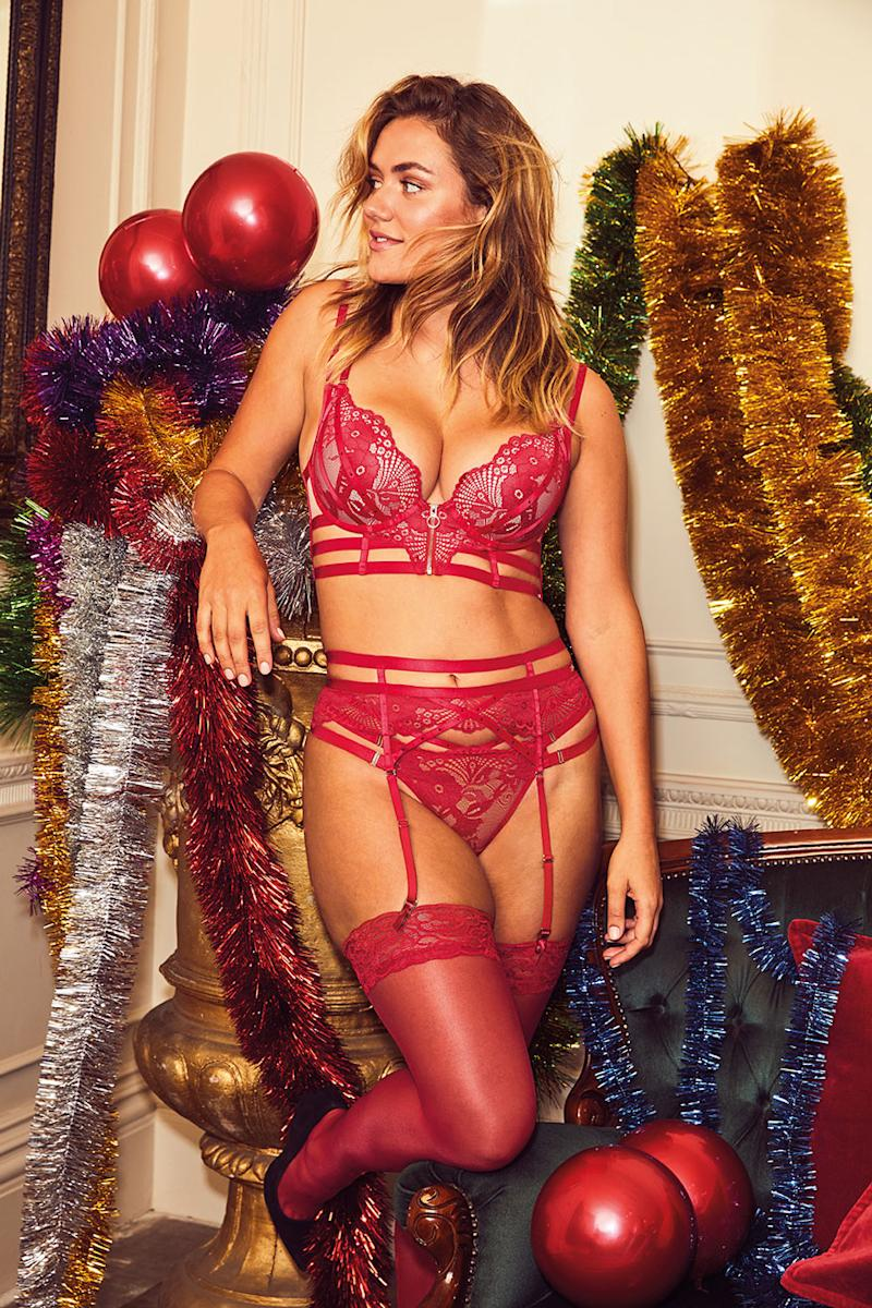 A photo of Katie Muirhead wearing a red matching bra, underwear and suspender in Bras N Things' holiday campaign.
