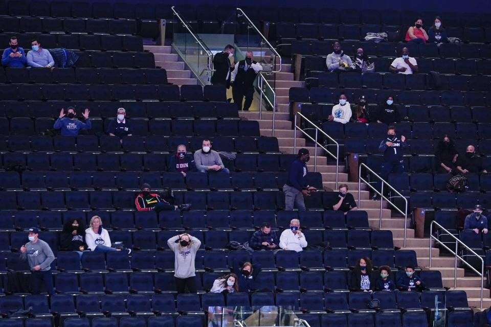 Fans watch during the first half of an NCAA college basketball game between Creighton and Connecticut in the semifinals in the Big East men's tournament Friday, March 12, 2021, in New York. (AP Photo/Frank Franklin II)