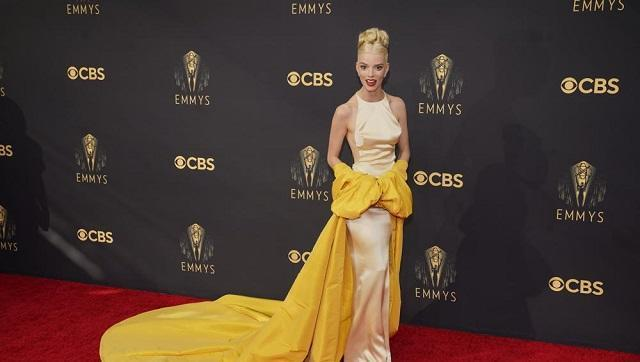 Anya Taylor-Joy wore a backless pale yellow Dior couture dress in satin with a dramatic yellow opera coat at the 73rd Primetime Emmy Awards (AP Photo/Chris Pizzello)