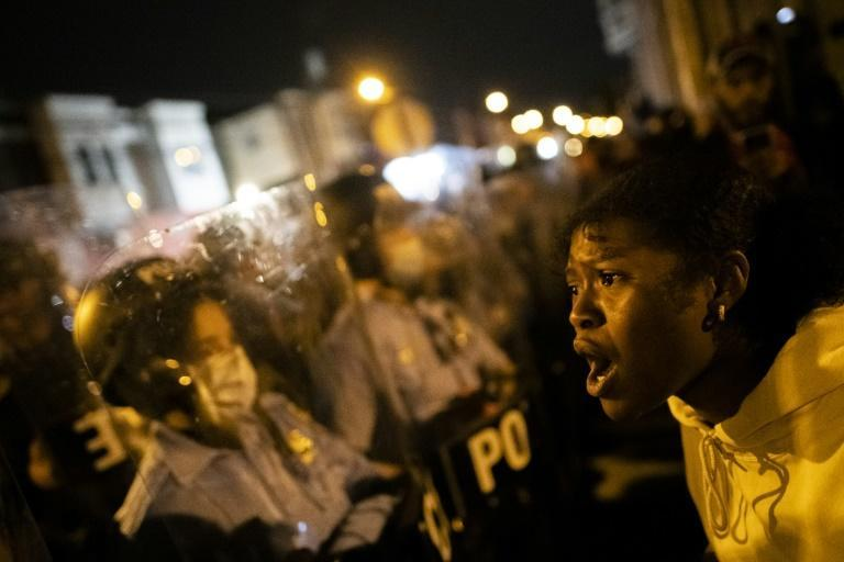 A demonstrator screams at a police line during a protest near the location where Walter Wallace, Jr. was killed by police officers