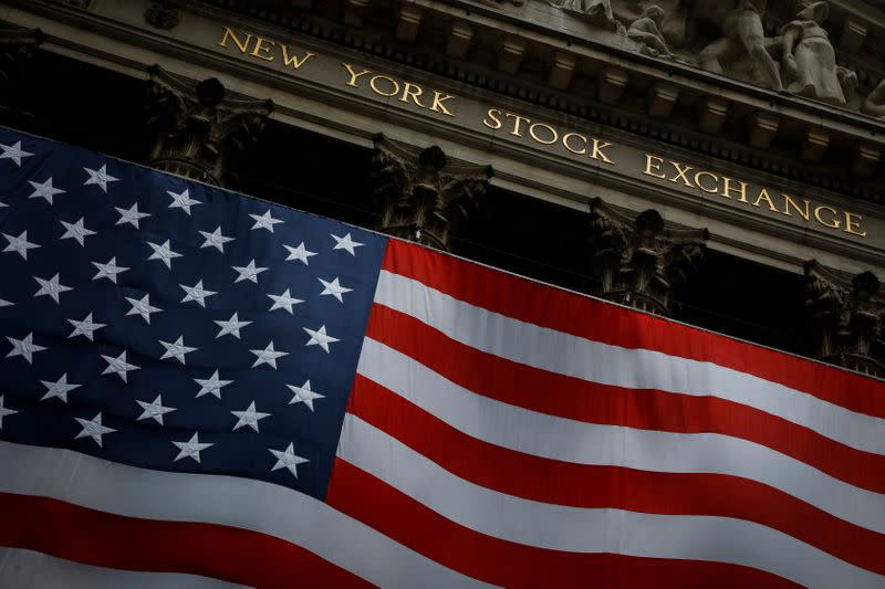Wall Street ends manic week with a gain