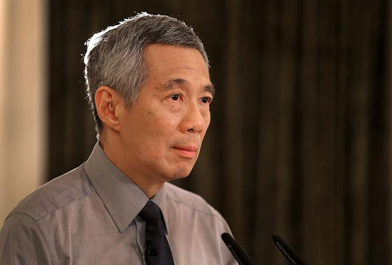 Singapore leader faces fresh criticism from brother amid family feud