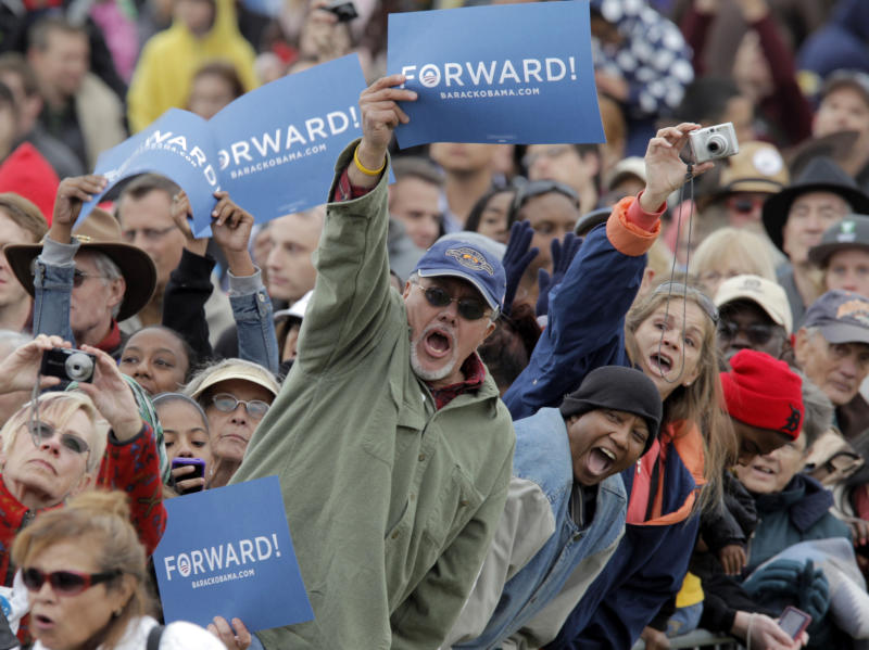 President Barack Obama supporters cheer the president at a campaign rally at City Park in Denver, Wednesday, Oct. 24, 2012. (AP Photo/Ed Andrieski)