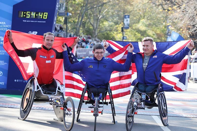 Second place winner, Marcel Hug,first place winner Daniel Romanchuk and third place winner David Weir celebrate during the TCS New York City Marathon on Nov. 3, 2019 in New York City. (Photo: PhotoRun/New York Road Runners via Getty Images)