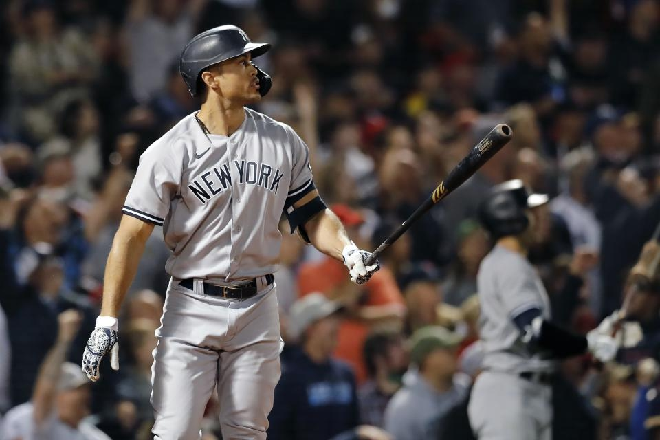 New York Yankees' Giancarlo Stanton watches his two-run home run during the eighth inning of a baseball game against the Boston Red Sox, Sunday, Sept. 26, 2021, in Boston. (AP Photo/Michael Dwyer)
