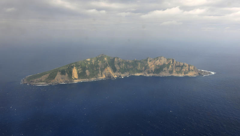 China plans to send surveyors to disputed islands