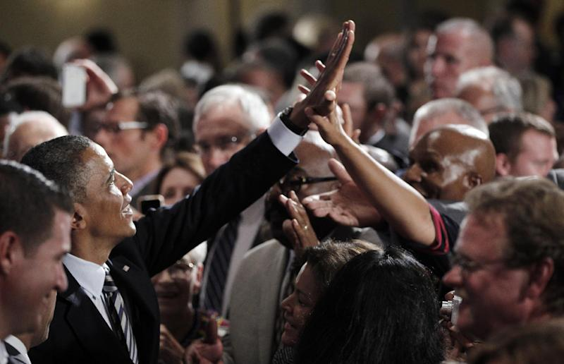 President Barack Obama greets supporters in the audience after speaking at a campaign fundraiser in Stamford, Conn., Monday, Aug., 6, 2012. (AP Photo/Pablo Martinez Monsivais)