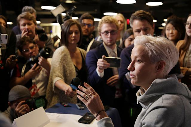 "United States women's national soccer team winger <a class=""link rapid-noclick-resp"" href=""/olympics/rio-2016/a/1124356/"" data-ylk=""slk:Megan Rapinoe"">Megan Rapinoe</a> speaks to reporters during the team's media day in New York. (AP)"