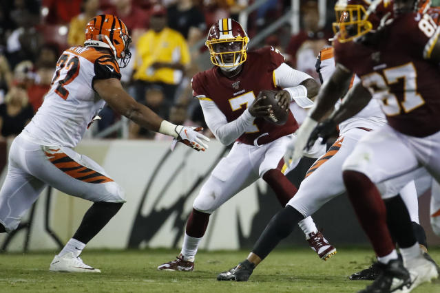 Cincinnati Bengals defensive end Kerry Wynn (72) comes in to sack Washington Redskins quarterback Dwayne Haskins (7) during the first half of an NFL preseason football game Thursday, Aug. 15, 2019, in Landover, Md. (AP Photo/Alex Brandon)