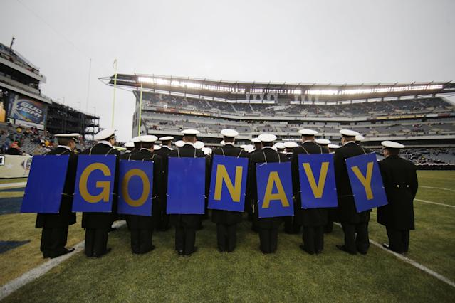 Navy midshipmen march off the field before an NCAA college football game against Army, Saturday, Dec. 14, 2013, in Philadelphia. (AP Photo/Matt Slocum)