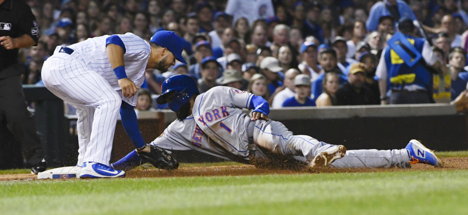 New York Mets' Amed Rosario (1) is caught stealing third base by Chicago Cubs third baseman David Bote, left, during the third inning of a baseball game on Tuesday, Aug. 28, 2018, in Chicago. (AP Photo/Matt Marton)