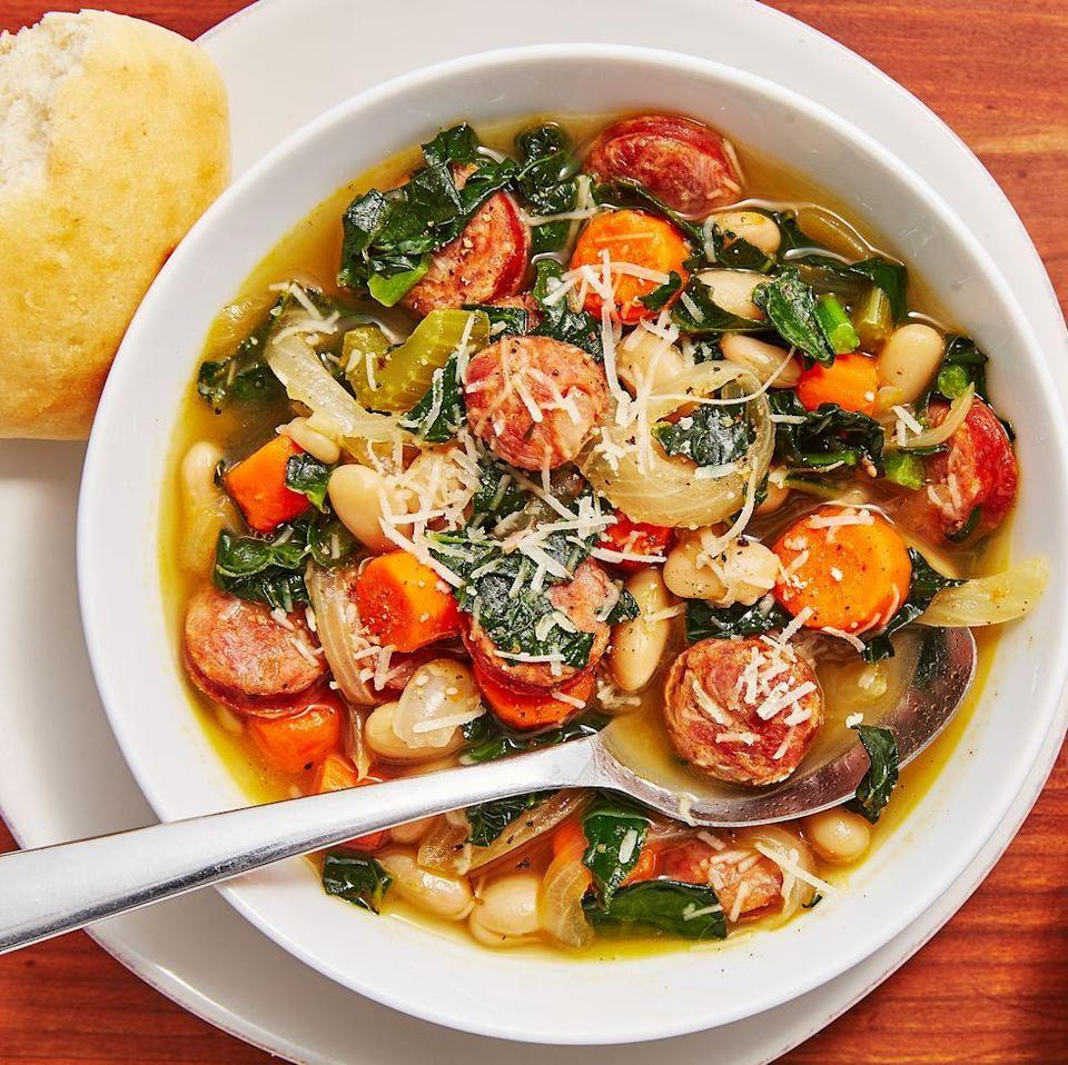 """<p>A good, hearty <a href=""""https://www.delish.com/uk/cooking/recipes/g28794441/vegetable-soup/"""" rel=""""nofollow noopener"""" target=""""_blank"""" data-ylk=""""slk:soup"""" class=""""link rapid-noclick-resp"""">soup</a> is one of our favourite ways to warm up in the colder months. And this Slow Cooker Sausage and White Bean Soup will do that perfectly. </p><p>Get the <a href=""""https://www.delish.com/uk/cooking/recipes/a29794477/slow-cooker-sausage-and-white-bean-soup-recipe/"""" rel=""""nofollow noopener"""" target=""""_blank"""" data-ylk=""""slk:Slow Cooker Sausage and White Bean Soup"""" class=""""link rapid-noclick-resp"""">Slow Cooker Sausage and White Bean Soup</a> recipe.</p>"""