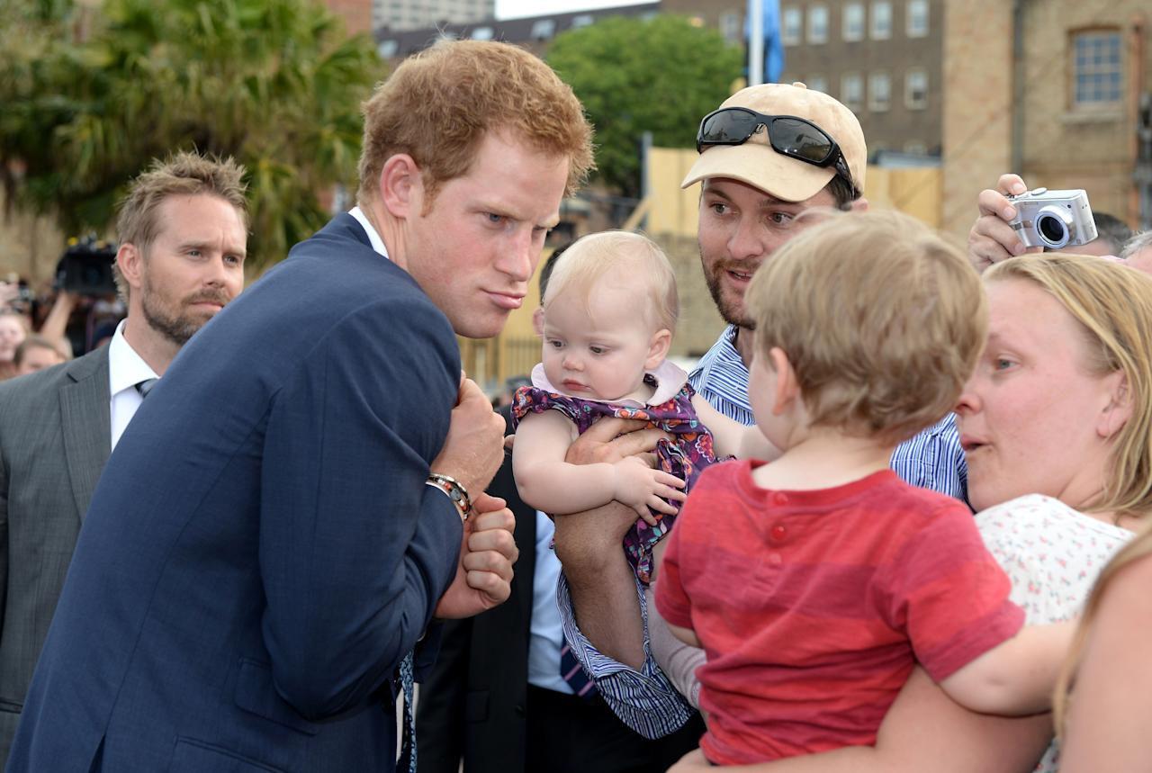 SYDNEY, AUSTRALIA - OCTOBER 05: Prince Harry is greeted by members of the public at Campbell's Cove during the 2013 International Fleet Review on October 5, 2013 in Sydney, Australia. Over 50 ships participate in the International Fleet Review at Sydney Harbour to commemorate the 100 year anniversary of the Royal Australian Navy's fleet arriving into Sydney. Prince Harry is an official guest of the Australian Government and will take part in the fleet review during his two-day visit to Australia. (Photo by Dan Himbrechts-Pool/Getty Images)