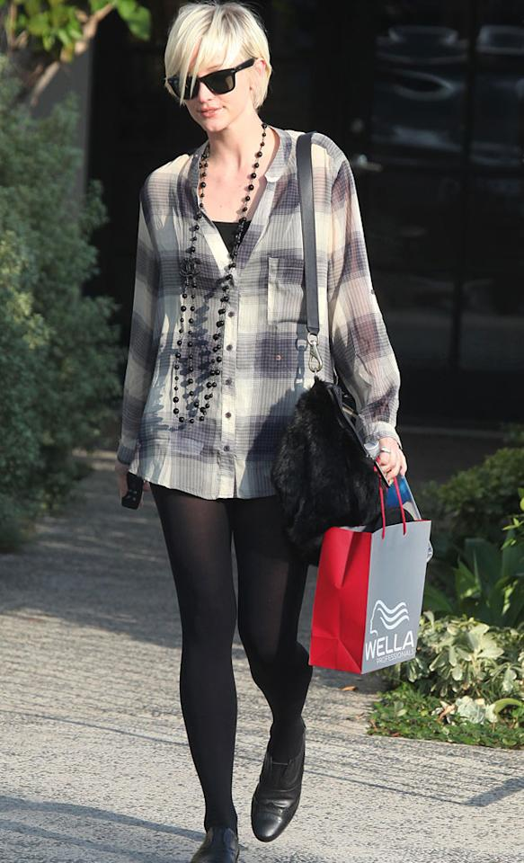 Ashlee Simpson went for an oversized grey tartan shirt