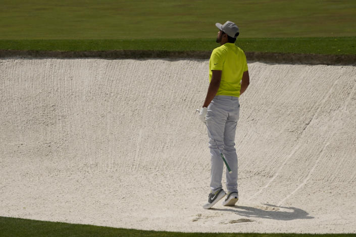 Tony Finau looks for his shot out of a bunker on the fourth hole during the final round of the Masters golf tournament on Sunday, April 11, 2021, in Augusta, Ga. (AP Photo/Charlie Riedel)