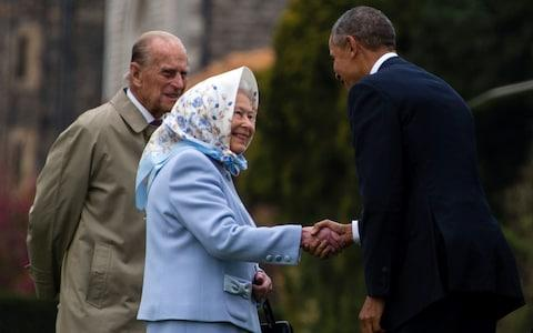 The Queen and Prince Philip greet former US President Barack Obama outside Windsor Castle in 2016 - Credit: JIM WATSON/AFP/Getty Images