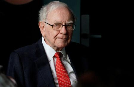 Warren Buffett, CEO of Berkshire Hathaway Inc, pauses while playing bridge as part of the company annual meeting weekend in Omaha