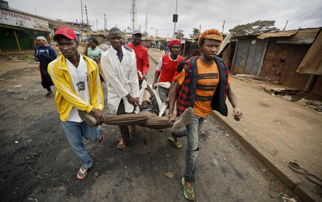 <p>Protesters carry away a man they said had been shot by police and was still alive, after police and protesters engaged in clashes in the Kawangware area of Nairobi, Kenya Thursday, Aug. 10, 2017. International observers on Thursday urged Kenyans to be patient as they awaited final election results following opposition allegations of vote-rigging, but clashes between police and protesters again erupted in Nairobi. (Photo: Ben Curtis/AP) </p>