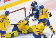 Sweden's goalie Hugo Alnefelt (30) is scored on by Finland's Roni Hirvonen (22) during the third period of an IIHL World Junior Hockey Championship game, Saturday, Jan. 2, 2021 in Edmonton, Alberta. (Jason Franson/The Canadian Press via AP)